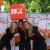 Andel de Haan (midden) en twee vriendinnen hielpen vorig jaar mee met PAX op het bevrijdingsfestival in Den Haag. Foto © PAX