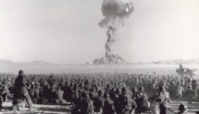 Troops Observing Dog Shot Detonation 1  November 1951. The atomic device dropped from an airplane detonates at a height of 1,417 feet, with the power of 21,000 tons of TNT. Fall 1951. Approximate distance 7 miles (11KM).  Photo - Defense Special Weapons Agency